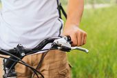 Male Hand Holding Handlebar Of Mountain Bike