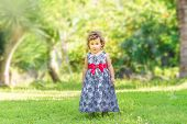 outdoor portrait of cute young child kid girl on natural green background