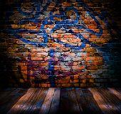 graffiti brick wall with plank wood