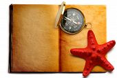 Compass And Red Seastar On Open Book
