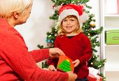 Little girl gives xmas postcard to grandmother