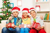Teens with Christmas presents in home interior