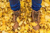 boots in fallen leaves