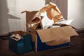 pic of messy  - Messy place with boxes on the floor - JPG