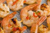 stock photo of tiger prawn  - Skewered Tiger Prawns with chilli pepper - JPG
