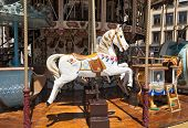 foto of carousel horse  - old carousel with a colorful wooden horse - JPG