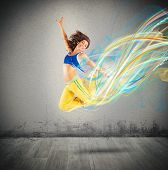 picture of  dancer  - Dancer jumps leaving a strip of colors