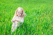 Beautiful Happy Little Girl Smiling Outdoors