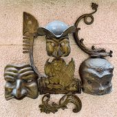 pic of venice carnival  - Ancient bronze sculpture on a wall medieval house as symbol of Venice  - JPG