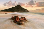 picture of foreground  - Zenith Beach views of Mt Tomaree in the first rays of morning light and ocean flows around foreground rocks - JPG