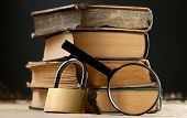 Old Books With Keylock And Magnifying Glass