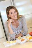 Portrait of beautiful blond woman in modern kitchen