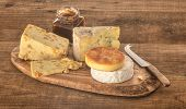 Cheese assortment on cutting board
