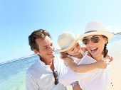 stock photo of 35 to 40 year olds  - Portrait of happy family at the beach - JPG
