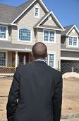 Businessman Looking at Real Estate