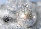 Silvery New Year's ball . Christmas still life