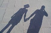 Couple in the sunny shadow