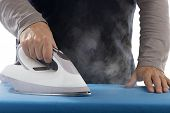 Hand of a Man Ironing with Steam