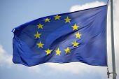 Closeup of the flag of the European Union waving.