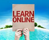 Learn Online card with a beach on background