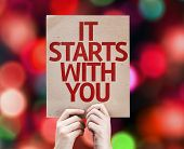 It Starts With You card with colorful background with defocused lights