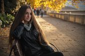 Girl The Bench Autumn Background With Yellow Leaves On