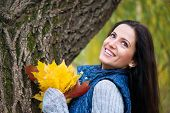Beautiful Girl Holding Yellow Autumn Leaves