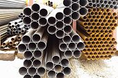 Heap Of Metal Pipes In Outdoor Warehouse
