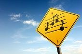 Free Music Area Ahead. Yellow Traffic Sign.