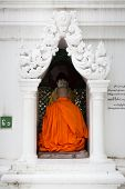 A Buddhist Monk Prays At Shwedagon Pagoda, In Yangon, Myanmar