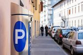 picture of mandates  - Machine parking on a city street and cars parked - JPG