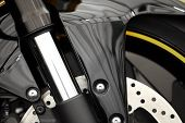 foto of suspension  - Color detail of the front suspension of a motorcycle - JPG