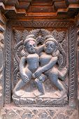 image of kamasutra  - Erotic wooden carving motif on a Hindu temple in Nepal - JPG