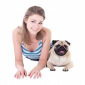 image of pug  - young beautiful woman lying with pug dog isolated on white background - JPG
