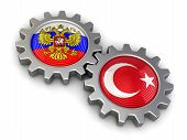 image of snatch  - Russian and Turkish flags on a gears - JPG