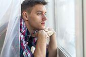 image of sad man  - Handsome pensive man guy watching through the window concept sadness sorrow pain waiting - JPG