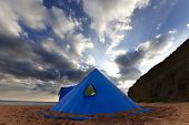 image of teepee tent  - Conical tent on summer beach in evening - JPG