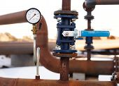 pic of manometer  - blue valve and manometer on rusty pipe close up - JPG