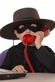 image of zorro  - child as costumed zorro at laptop helpdesk - JPG