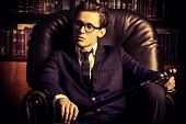 picture of respect  - Respectable handsome man in his office - JPG