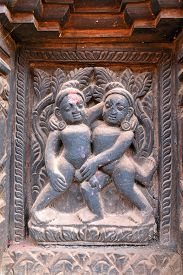 stock photo of lingam  - Erotic wooden carving motif on a Hindu temple in Nepal - JPG