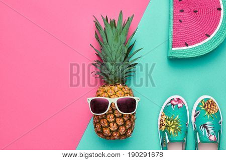 poster of Fashion Hipster Pineapple Fruit. Bright Summer Color, Accessories. Tropical pineapple with Sunglasses, Stylish Handbag Creative Art concept. Minimal style. Pink blue summer party background