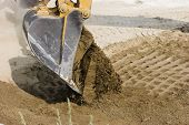 Excavators Dumping Its Load Of Dirt.