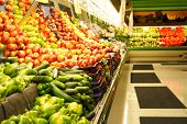 picture of grocery store  - A shot of fruit and vegetables section in a grocery store - JPG