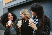 Group Of Female Friends Having Ice Coffee Outdoors poster