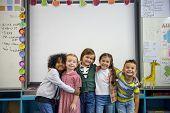 Group of diverse kindergarten students standing together poster