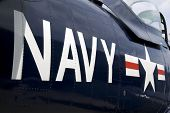 stock photo of fighter plane  - US Navy markings on the side of a restored vintage aircraft - JPG