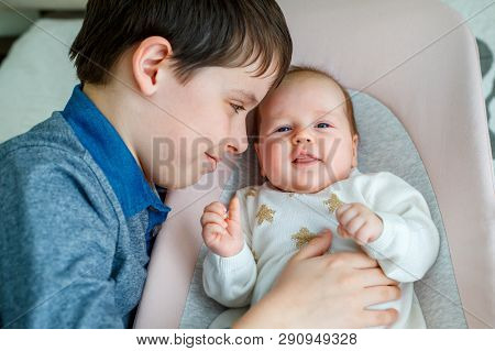 Big Brother Hugging His Newborn