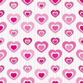Solid-filled hearts ?cutout? from each other in various shades of pink arranged on seamless tile with miniature heart stripes