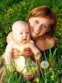 picture of mother baby nature  - smiling mother and baby in the park - JPG